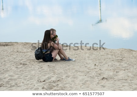 mom and son rest on the sand near the lake stock photo © tekso