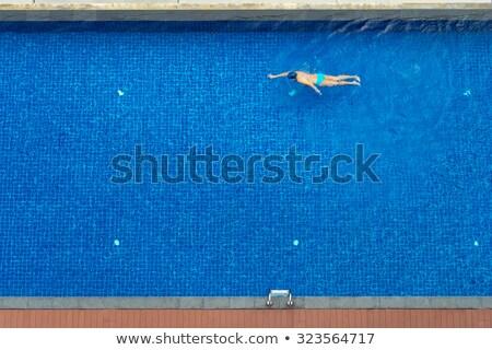 Rear view of man swimming stock photo © wavebreak_media