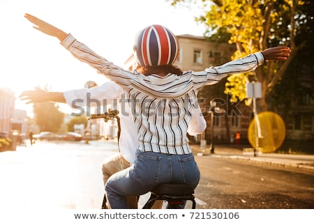 Back view of african couple rides on modern motorbike Stock photo © deandrobot