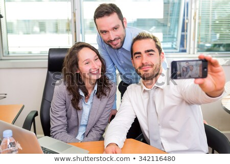 Three business associates at work. Stock photo © IS2