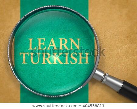 Learn Turkish through Loupe on Old Paper. Stock photo © tashatuvango
