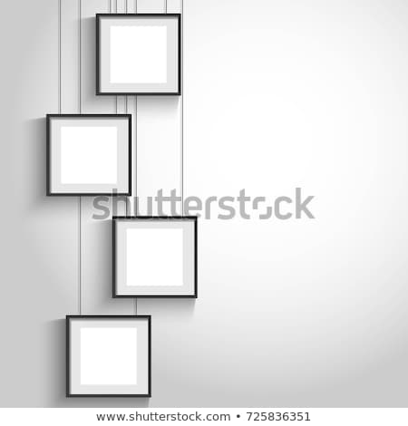 empty photo frames hanging on wall stock photo © lightfieldstudios