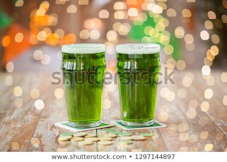 Szemüveg zöld sör arany érmék asztal Szent Patrik napja Stock fotó © dolgachov