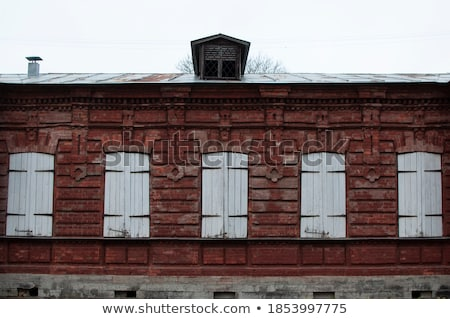 Old stone houses with lantern and windows with shutters Stock photo © bezikus