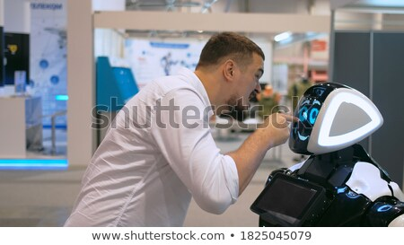 angry male robot stock photo © cthoman