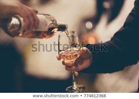 Rose wine glass and corkscrew Stock photo © karandaev