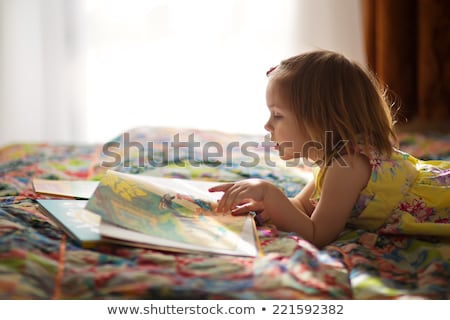 little kids reading book in bed at home stock photo © dolgachov