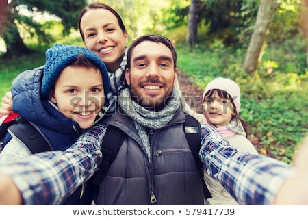 happy family hiking and taking selfie Stock photo © dolgachov