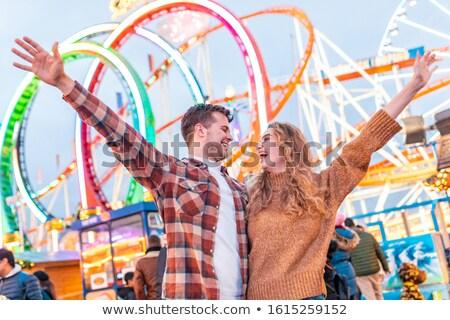 happy couple having fun on a rollercoaster stock photo © minervastock