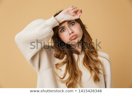 Portrait of an upset young woman wearing sweater Stock photo © deandrobot