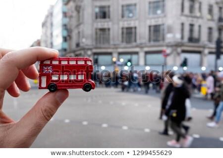 Minyatür insanlar kırmızı otobüs üst etrafında Stok fotoğraf © nito