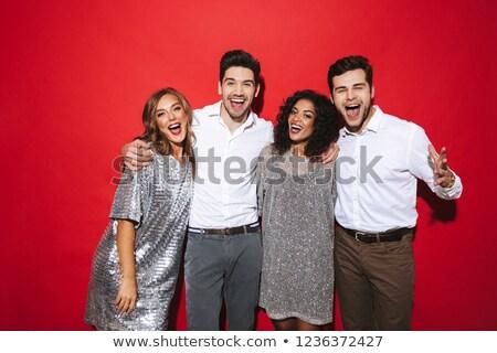 Grupy cztery szczęśliwych ludzi smart nowy rok Zdjęcia stock © deandrobot