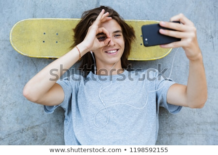 top view of a smiling young teenge boy spending time stock photo © deandrobot