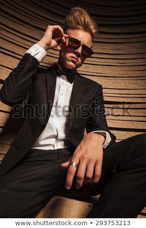 человека · костюм · Солнцезащитные · очки · сидят · подоконник · студию - Сток-фото © feedough