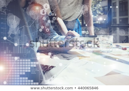 Business woman working on tablet with new idea concept Stock photo © ra2studio
