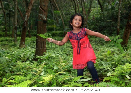 Children playing red indians in the garden Stock photo © colematt