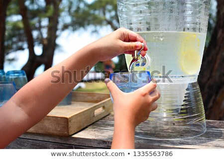Kid pouring lemonade on the candy bar Stock photo © dashapetrenko