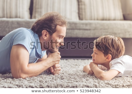 portrait of happy son with father at home stock photo © lopolo