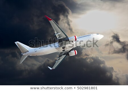 Stock photo: Airliner wing with turbine on dark background