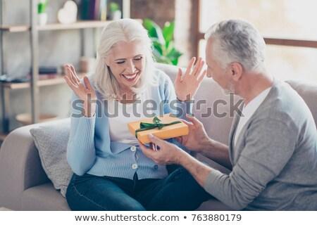 женщины белые волосы глядя муж Сток-фото © pressmaster
