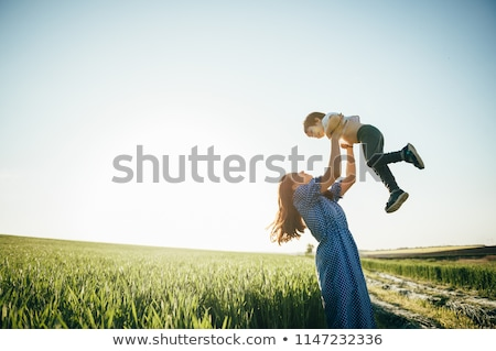 Father and son having fun outdoors in the meadow Stock photo © Lopolo