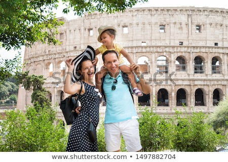 Young Family Standing In Front Of Colosseum Stock photo © AndreyPopov