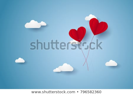 happy couple with red heart shaped balloons stock photo © dolgachov