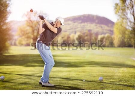 Elder golf player teeing off. Stock photo © lichtmeister