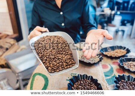Different kinds of coffee beans in the roastery Stock photo © Kzenon