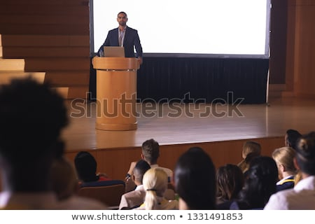 Front view of mixed race businessman giving speech in front of audience in the auditorium Stock photo © wavebreak_media