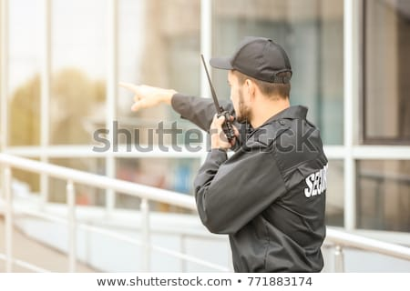 Young Security Guard Talking On Walkie-talkie Stock photo © AndreyPopov