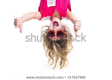 A Little with head upside down in studio Stock photo © Lopolo