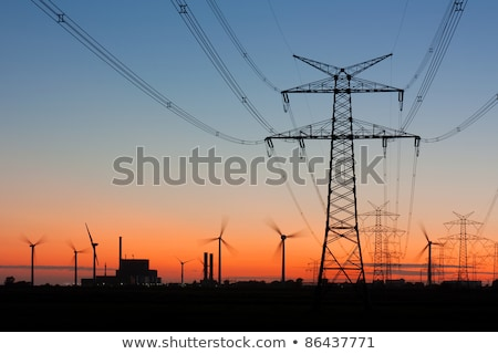 Overhead transmission lines and wind turbines Stock photo © elxeneize