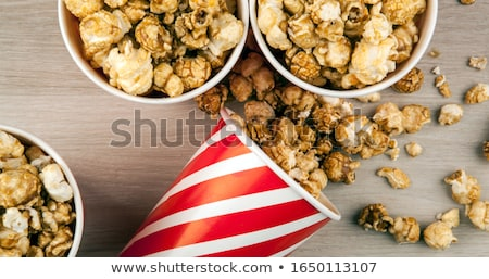 many red cardboard cup with sugar popcorn on a wooden table Stock photo © mizar_21984
