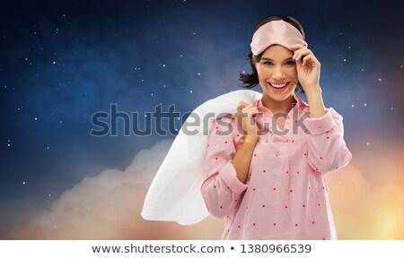happy woman in pajama with pillow over night sky Stock photo © dolgachov