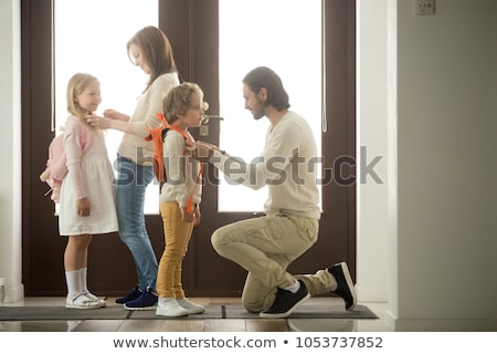 Father Helping Son Get Ready Stock photo © ArenaCreative