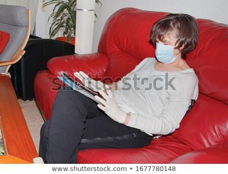 Nő latex ül fotel piros cipő Stock fotó © phbcz