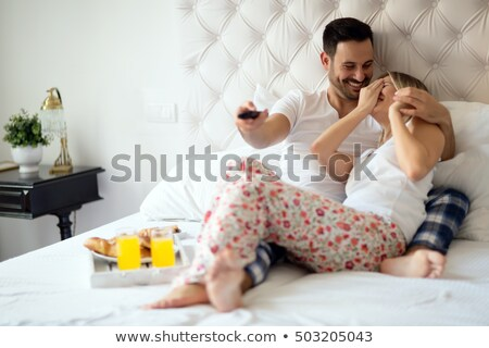 Married couple relaxing on bed Stock photo © photography33