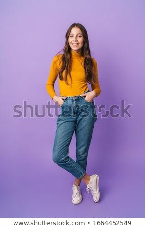 Attractive teenager posing in studio Stock photo © weecy