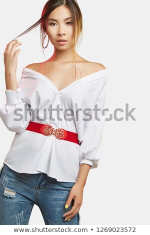 Beautiful dark-haired pretty girl in jeans and white blouse read Stock photo © HASLOO