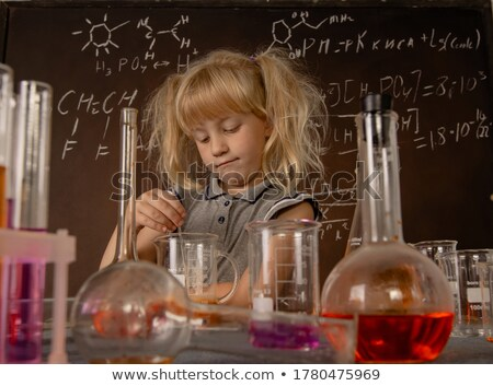 Little girl conducting experiment on oranges Stock photo © photography33