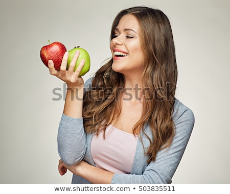 Woman holding two red apples Stock photo © photography33