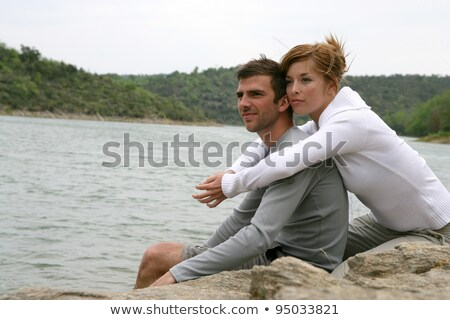Couple sat together in the wild stock photo © photography33