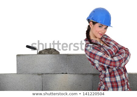 Stonemason standing proudly next to her work Stock photo © photography33