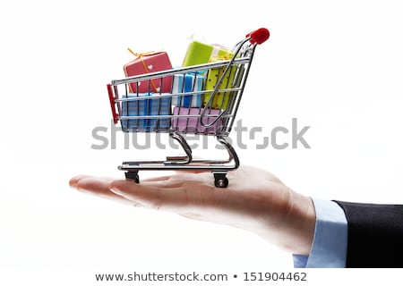 shopping cart on palm of businessman stock photo © vlad_star
