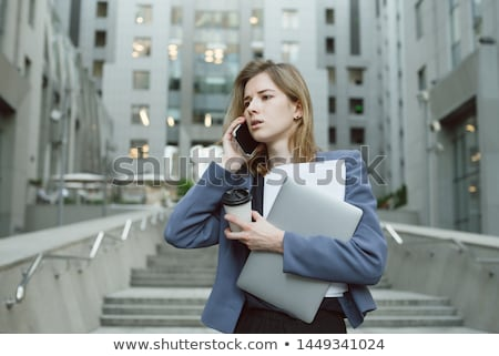 businesswoman on the phone having cup of coffee stock photo © photography33