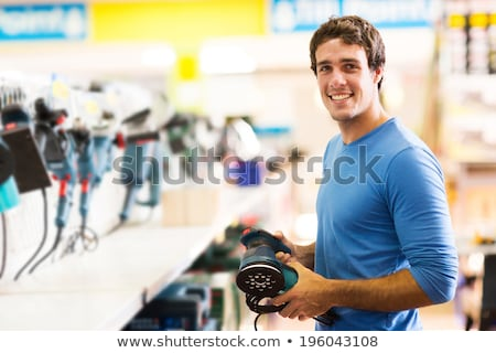 Young man holding a sander Stock photo © photography33