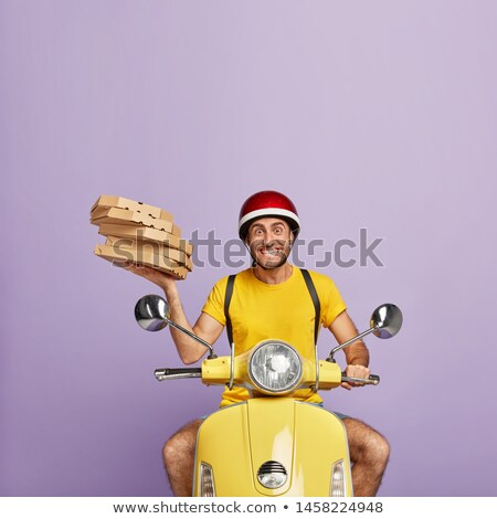 Guy overloaded with pile of cartons Stock photo © stockyimages