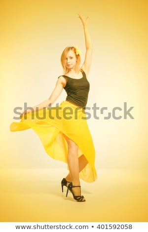 salsa dancer posing in a yellow dress Stock photo © feedough
