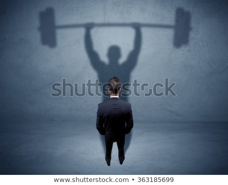 Businessman lifting weights stock photo © photography33